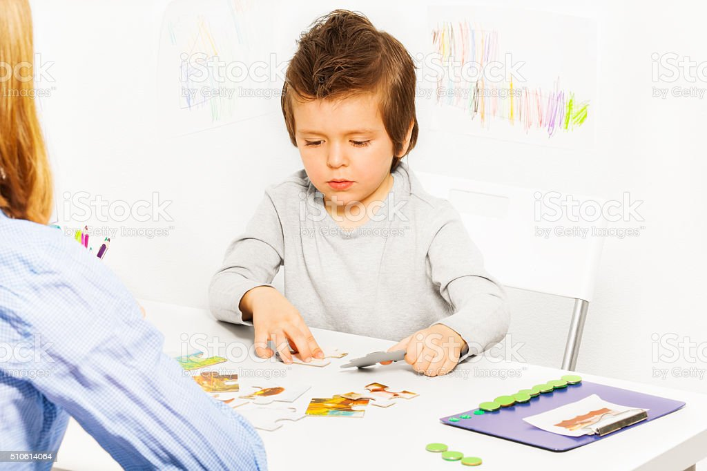Concentrated solve puzzle during developing game stock photo