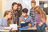 istock Concentrated teenagers in light classroom 639182660