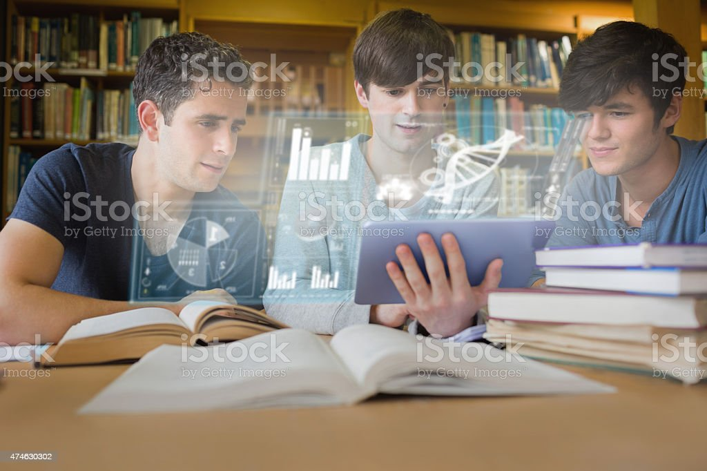 Concentrated young men studying medicine together with futuristi stock photo