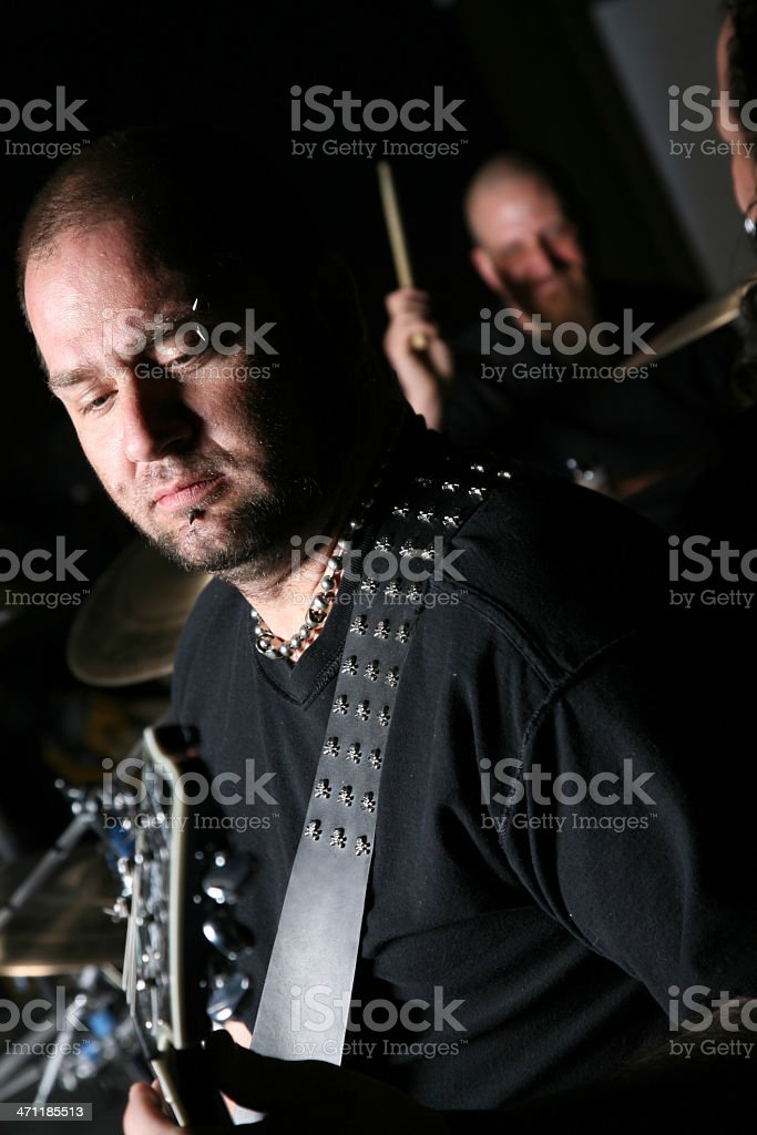 Concentrating Guitar Player and Band royalty-free stock photo
