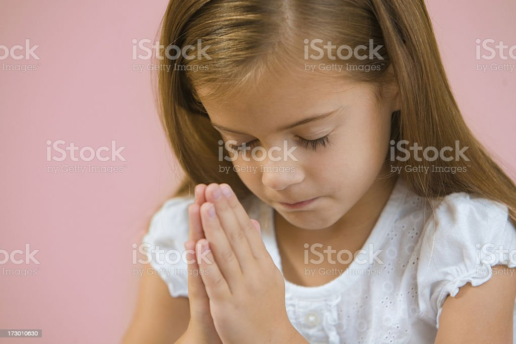Concentrating in Prayer royalty-free stock photo