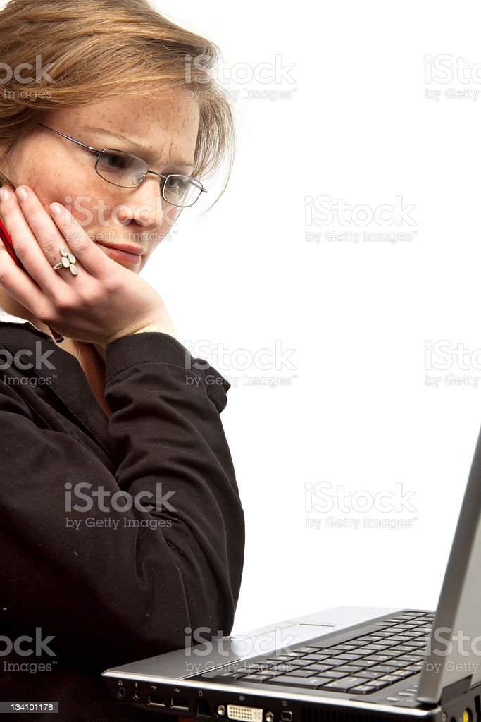 Concentrating on her laptop royalty-free stock photo