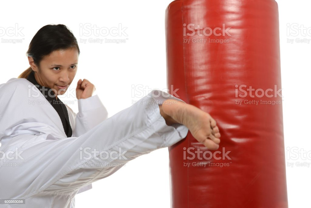 Concentration and Kick on the Punching Bag stock photo