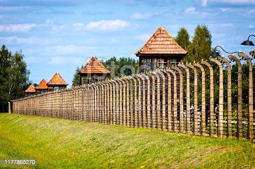 Auschwitz - Birkenau, Poland - August 11, 2019:The guard's watch tower and fence of barbed wire, Auschwitz - Birkenau concentration camp, Poland