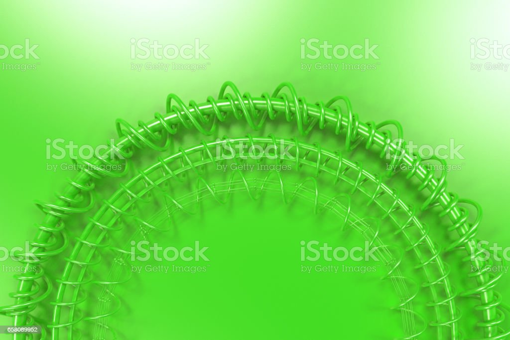 Concentric shape made of rings and spirals on green background royalty-free stock photo