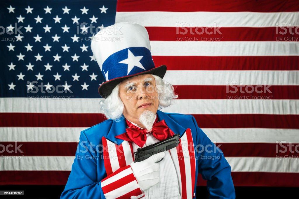 Concept 2nd Amendment  - Uncle Sam holding a hand gun stock photo