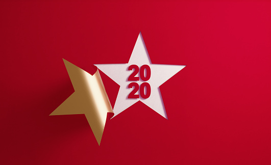 istock 2020 Concept- A Golden Star Shape Folding on Red Background 1189818322