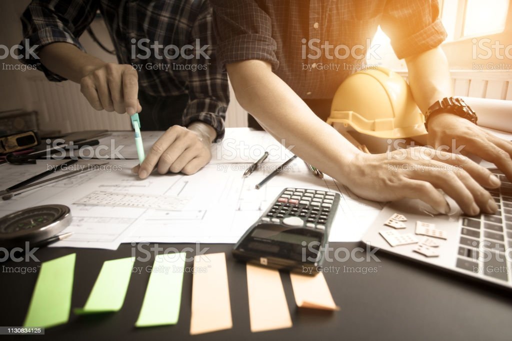 Concept Agreement between the employer and architect Nick and desk of...