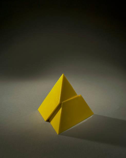 Concept amalgame golden Yellow pyramid as symbol of business stability Mumbai