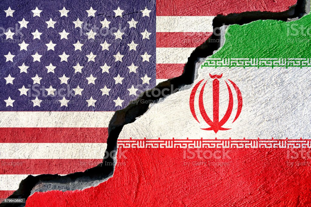 Concept american and Iran flag on cracked background stock photo