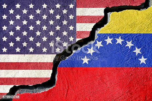 Concept american and Venezuela flag on cracked background
