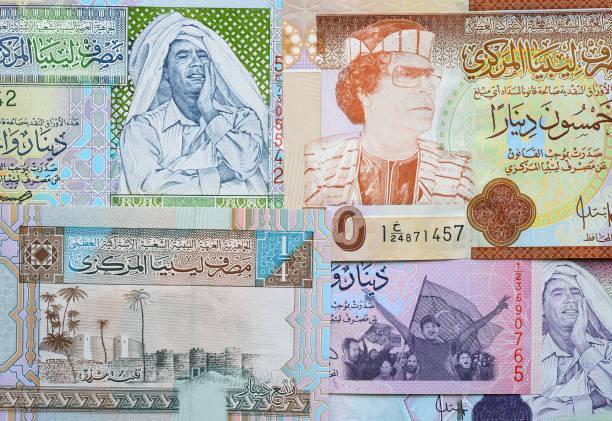 Concept: Arab spring. Muammar Gaddafi on Libya 50 dinar (2008) banknote stock photo