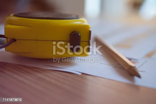 832105172 istock photo Concept architects, equipment architects On the desk with a blueprint in the office, Vintage. Selective Focus 1141873610