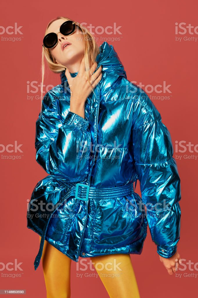Concept art image of slim blonde girl in studio, wearing blue down...