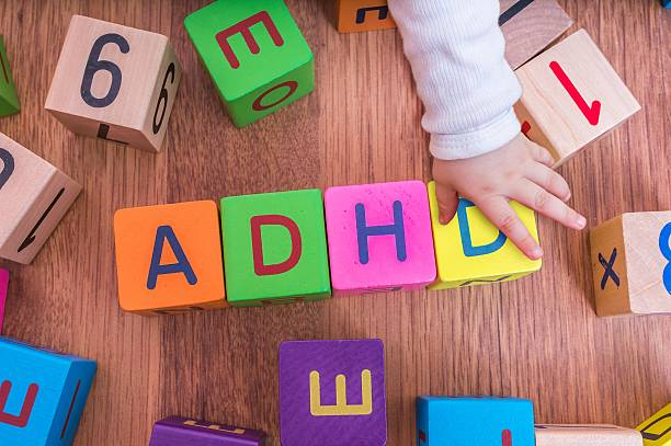 ADHD concept. Baby is playing with cubes with letters. stock photo