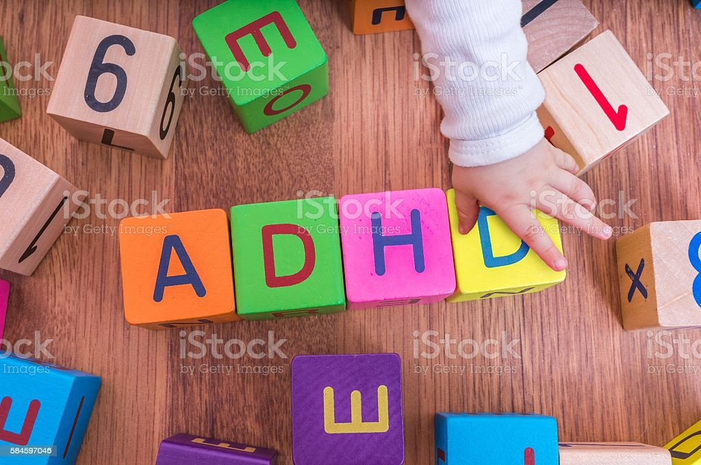 ADHD concept. Baby is playing with cubes with letters. – zdjęcie
