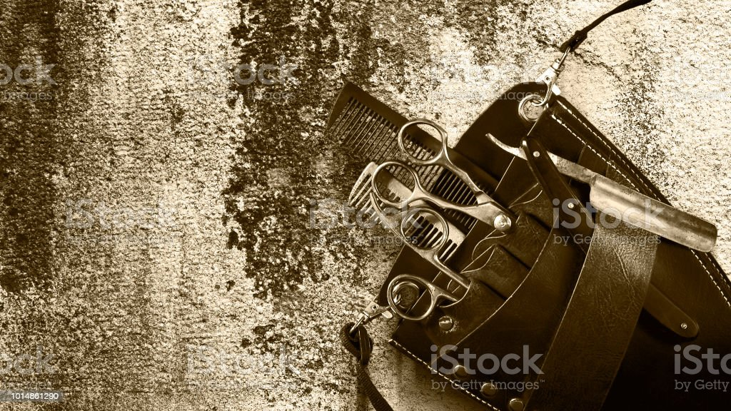 Concept Barber Shop. Set of hairdressing tools an old vintage wall. Toned. Sepia. Copy space Beauty. - foto stock