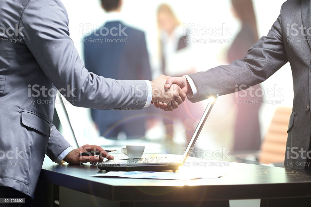 concept - benefits from successful cooperation. the handshake bu stock photo