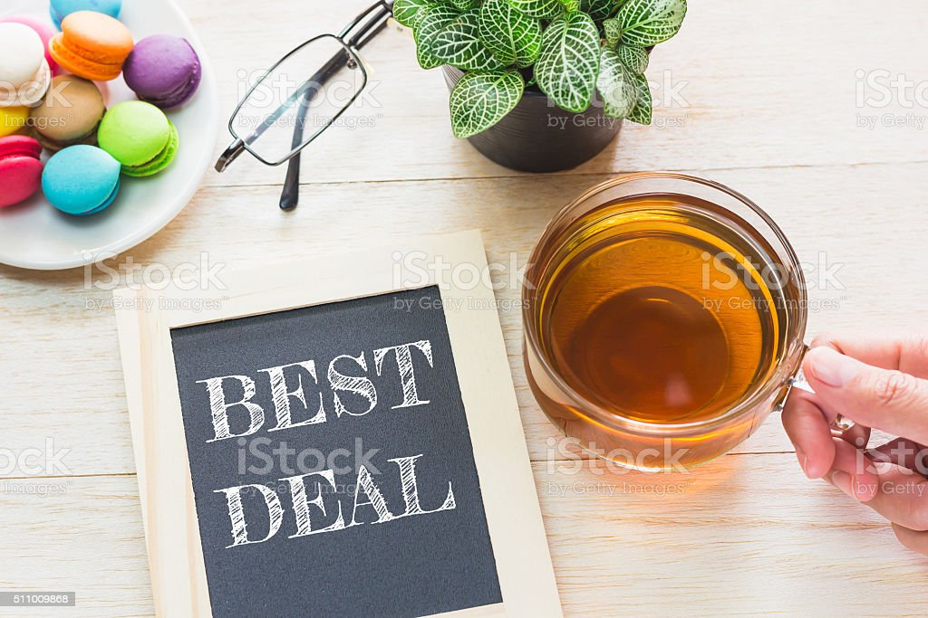 Concept BEST DEAL message on wood boards. stock photo