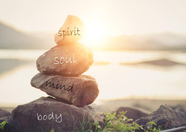 Concept body, mind, soul, spirit Holistic health concept of zen stones / Concept body, mind, soul, spirit, wellbeing stock pictures, royalty-free photos & images
