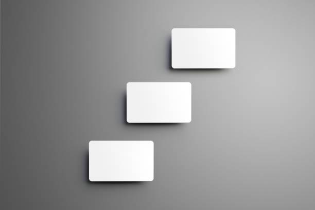 konzept business modell für die drei bank-geschenk-karten mit schatten auf einem hintergrund. - gutschein ausdrucken stock-fotos und bilder