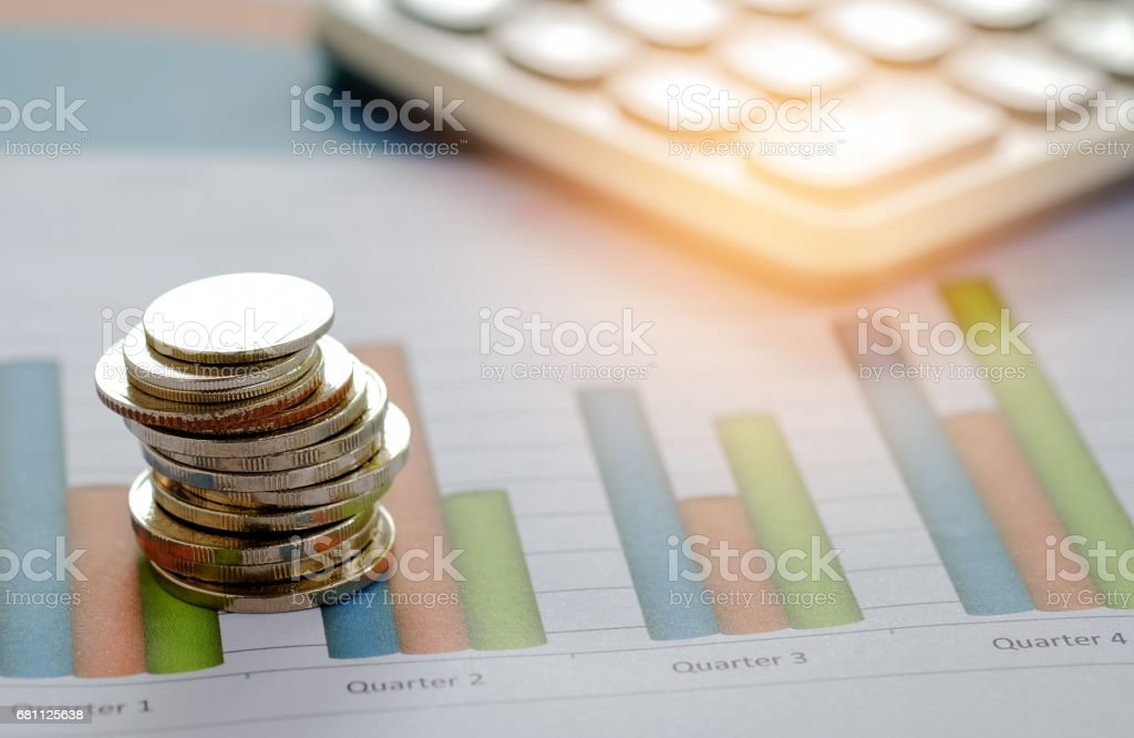 Concept businness,Coin and calculator placed on the graph. royalty-free stock photo