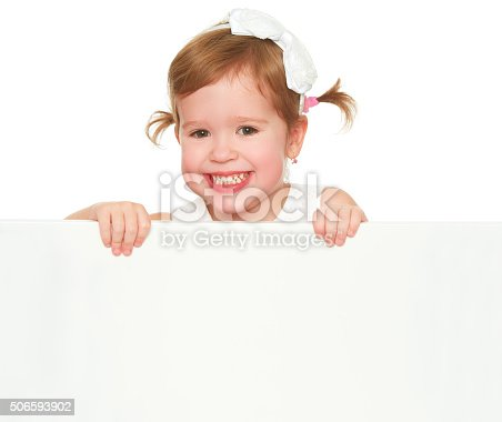 519837800 istock photo concept child girl with white blank poster isolated 506593902