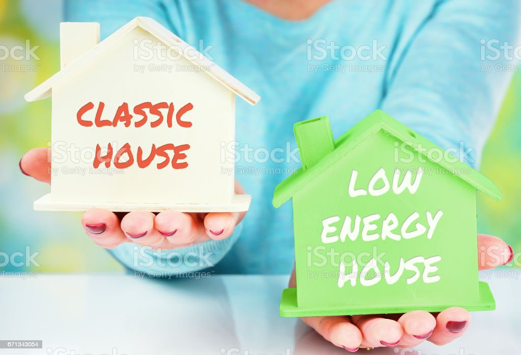 concept comparison between normal house and low consumption house stock photo