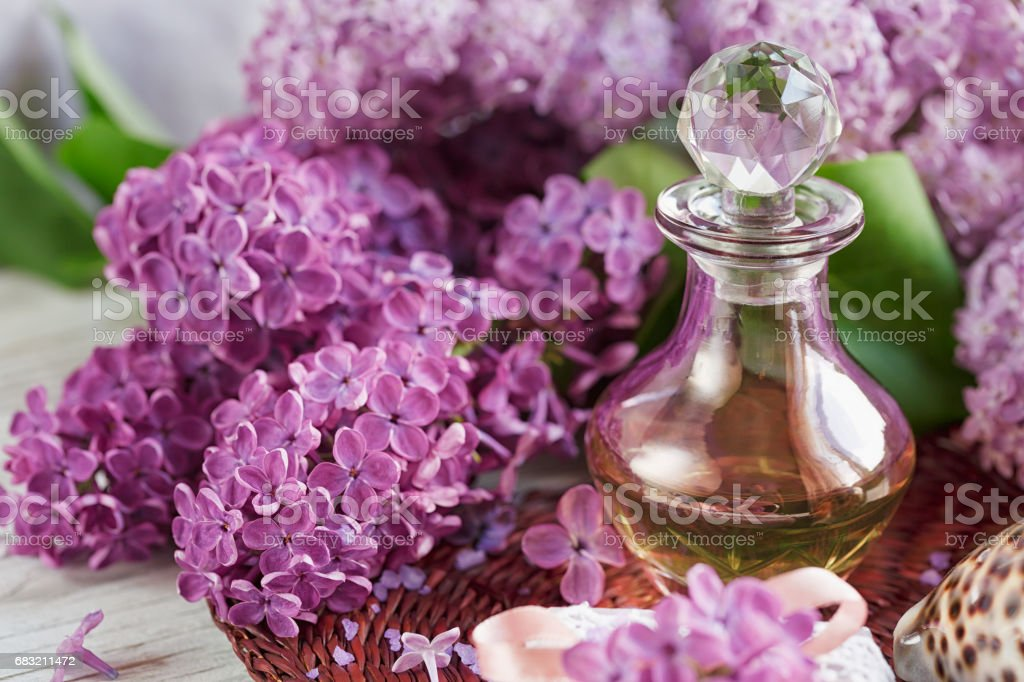 SPA concept: composition of spa treatment with natural sea salt,  aromatic oil and lilac flowers royalty-free 스톡 사진