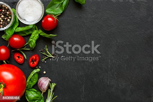 istock concept cook work with vegetables, spices and herbs on dark background. 840666464