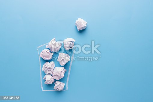 istock Concept. Creased paper in a trash can 938134188