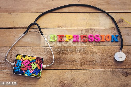 1091817198 istock photo concept depression, heart stethoscope and colorful letters in metal box 941071728