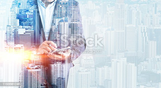 Concept double exposure Male businessmen who use smartphones to work mix with background of the city is blurred,City life and internet usage on a daily basis