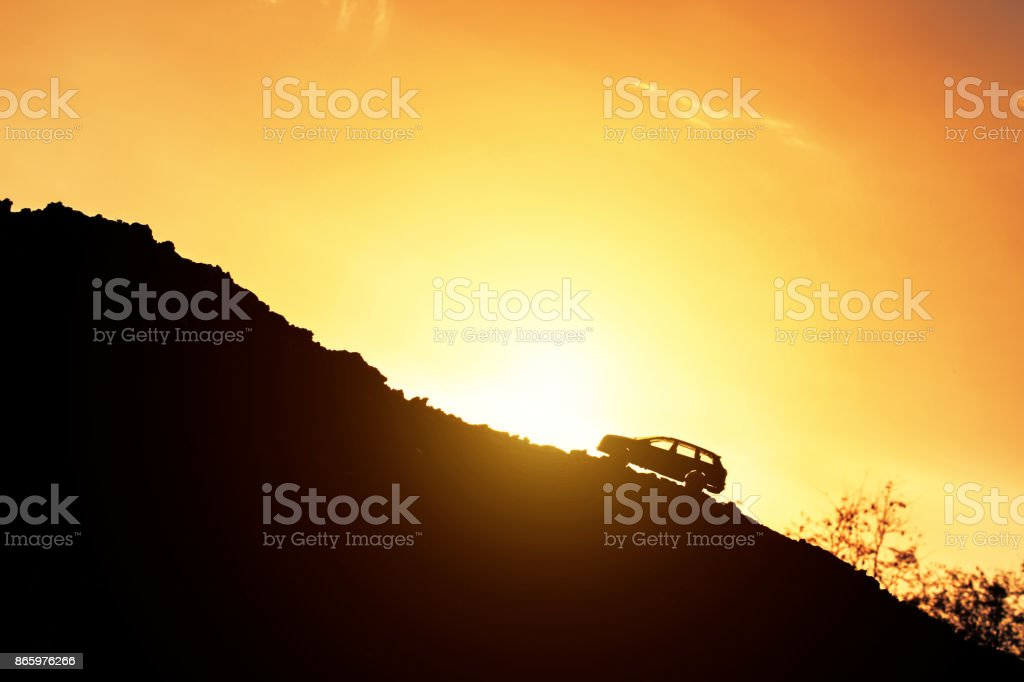 Toy car drive uphill and light of sunrise. Concept effort