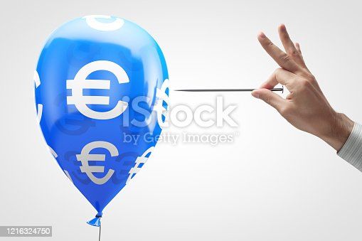 Concept: European currency vulnerability. Balloon with euro symbol and needle in hand