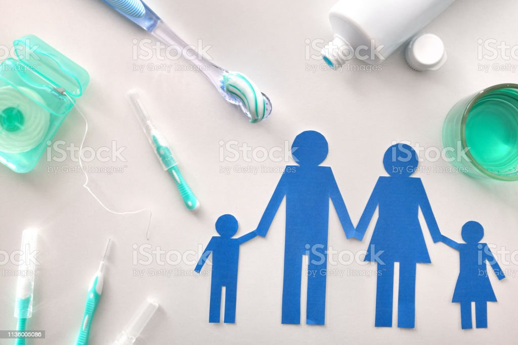 Concept family dental hygiene with tools on white table general stock photo