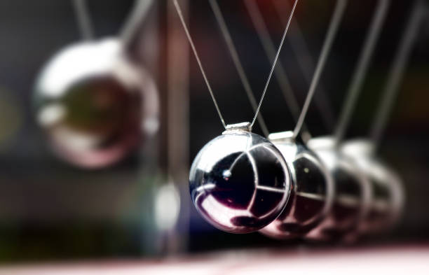 Concept For Action and Reaction in Business With Newton's Cradle stock photo