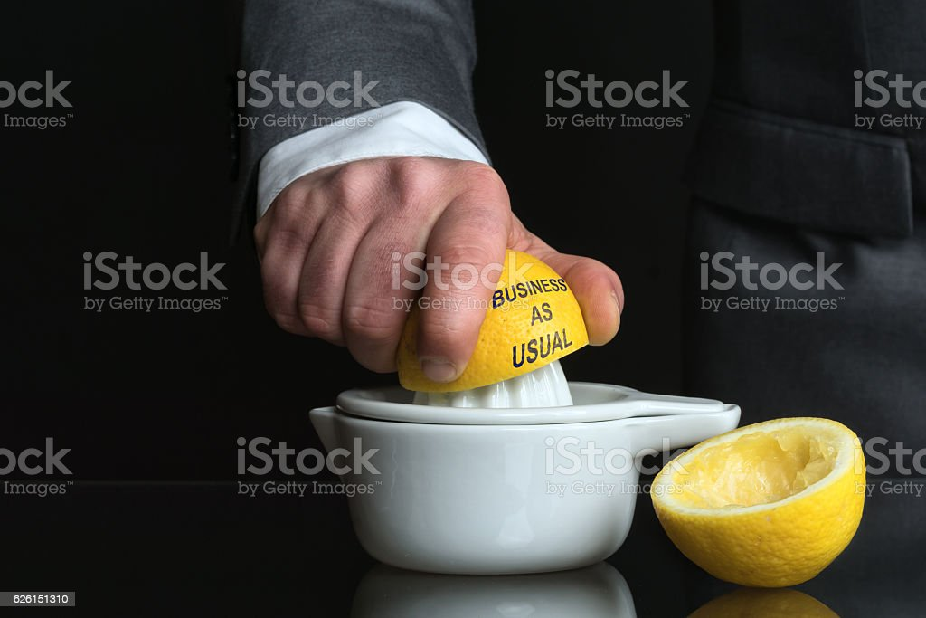 Concept for Business as usual with Man and Lemon stock photo