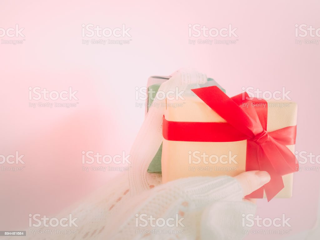 concept for christmas and new year event with close up beauty hand woman with winter cloth holding gift box and give it to pauper person stock photo