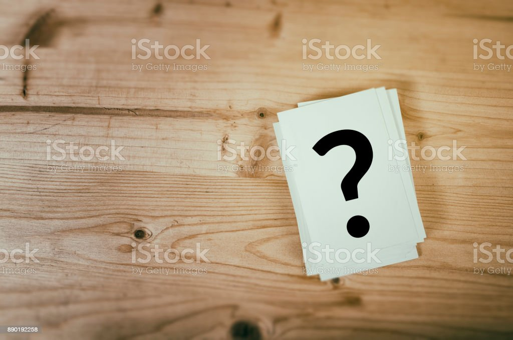 Concept for confusion, question or solution Question mark on wooden desk background. Concept for confusion, question or solution. Advice Stock Photo