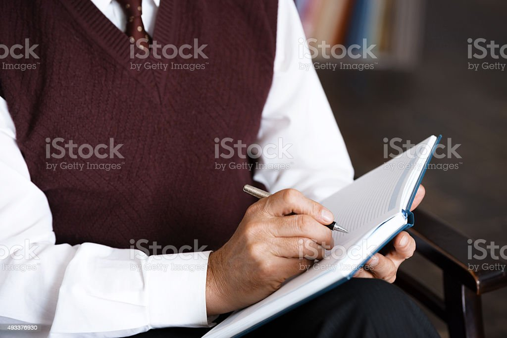 Concept for consultation with psychologist Close up photo of male psychologist. Psychologist making notes in psychologist office 2015 Stock Photo