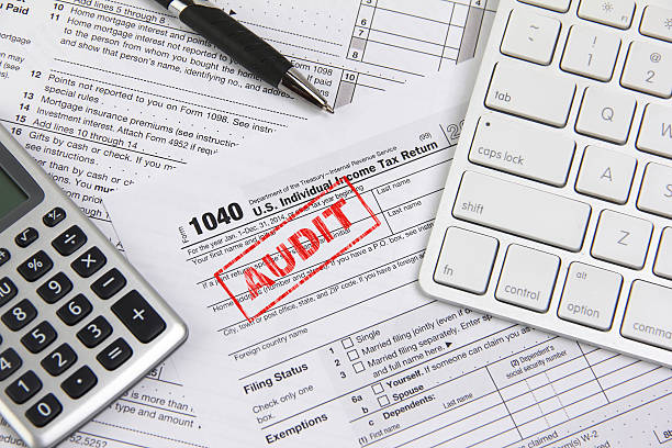 Concept for filing online taxes and being audited stock photo