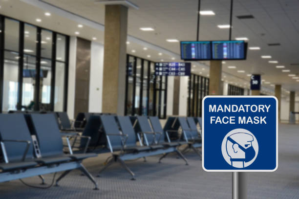 Concept for mandatory use of face mask in airport stock photo