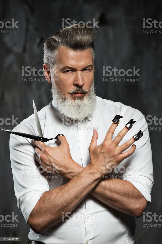 Concept for stylish adult man with beard stock photo
