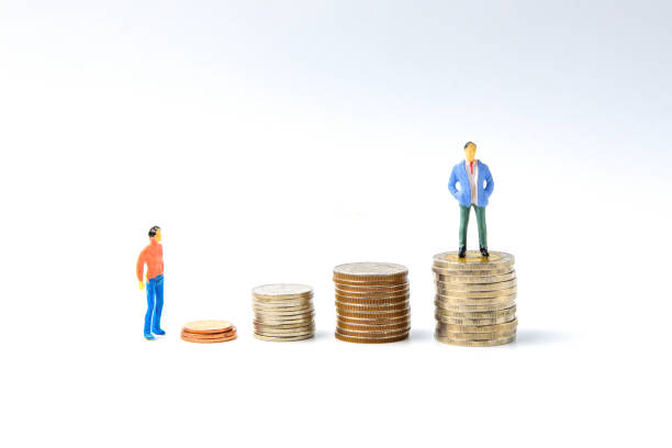 concept for success ladder miniature people: small business figure standing on stack of coin. money and financial concepts. - figurine stock photos and pictures