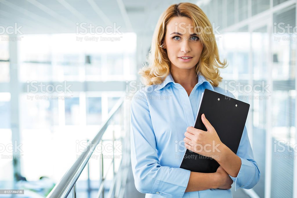 Concept for young secretary in modern office stock photo