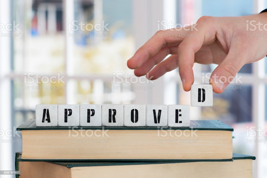 APPROVED Concept , Hand with alphabet blocks stock photo