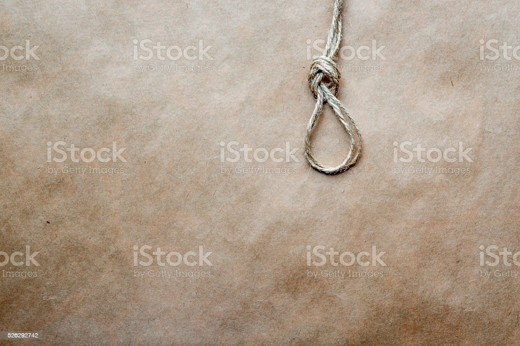 concept hangman's knot on kraft paper background stock photo