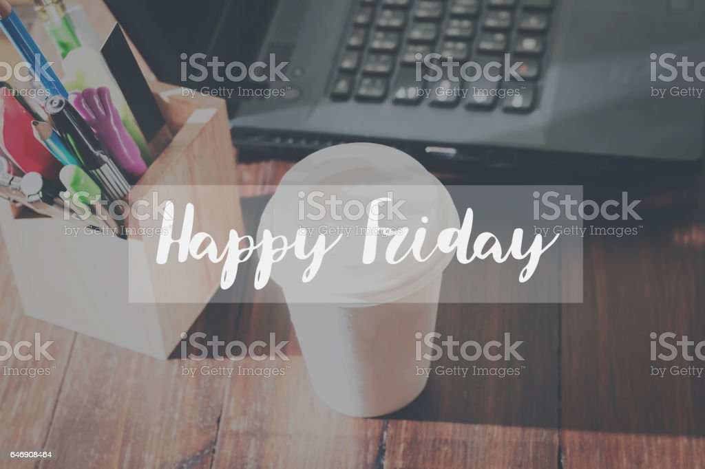 Concept Happy friday message on the device works the table background stock photo