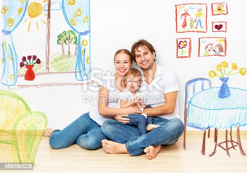 istock Concept : happy young family in  new apartment dream 489390028